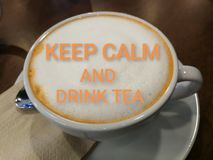 Keep calm and drink tea, phrase on how to t milk tea foam royalty free stock image