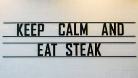 Keep calm and eat steak sign. Keep calm and eat steak sign in the restaurant Royalty Free Stock Images
