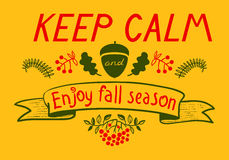 Keep calm and enjoy autumn inspirational quote. Royalty Free Stock Photo