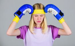 Keep calm and get rid of headache. Beat headache. Girl boxing gloves tired to fight. Strong woman suffer pain. Girl. Painful face embrace head with boxing stock photos
