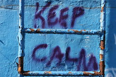 Keep calm. Grafitti in the old abandoned pool Royalty Free Stock Photo