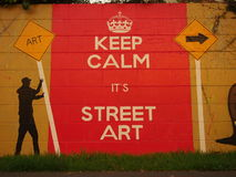 Keep calm, it's street art. Street art mural on fence following Rise - Street Art festival in Christchurch, New Zealand Stock Photos