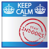 Keep Calm And Stay Indoors Badge. A keep calm and stay indoors badge isolated on a white background Stock Photography