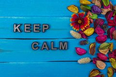 Free Keep Calm Text On Blue Wood With Flower Stock Photos - 120576083