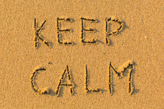 KEEP CALM - words hand-written on sand beach. Abstract. Royalty Free Stock Photography