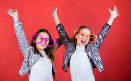 Keep celebrating. Cool party girls wearing fancy glasses. Small kids in party goggles having fun. Party girls. Happy. Children enjoy dancing party royalty free stock image