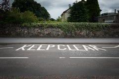 Keep clear on an asphalt road Stock Photography