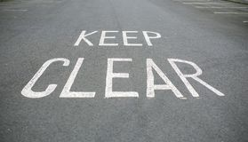 Keep clear signal on the road.  Royalty Free Stock Image