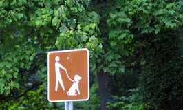 Keep dogs 'On Leash' signs. Are plentiful not only at open beaches, but also on parks and at stop stations on many U.S. highways Royalty Free Stock Images