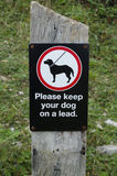 Keep dogs on leads Stock Photo