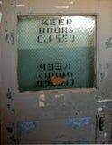Keep door closed. Old door in an industrial building royalty free stock photo