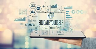 Keep educate yourself with tablet computer. Keep educate yourself with man holding a tablet computer stock photo