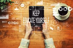 Keep educate yourself with a person holding a tablet. Computer royalty free stock photos