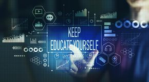 Keep educate yourself with young man pointing. On a dark background royalty free stock photo