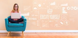 Keep educate yourself with woman using a laptop. Keep educate yourself with young woman using her laptop in a chair royalty free stock photo
