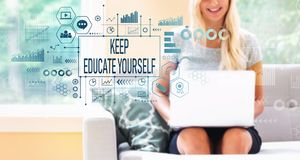Keep educate yourself with woman using a laptop. Keep educate yourself with young woman using a laptop computer royalty free stock image