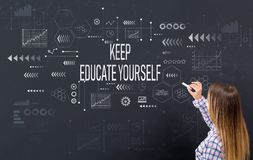Keep educate yourself with young woman. Writing on a blackboard royalty free stock image