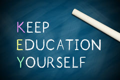 Keep Educating Yourself. Written on chalkboard with a white chalk Royalty Free Stock Images
