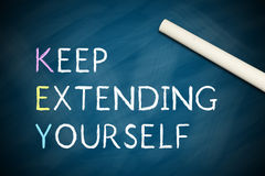 Keep Extending Yourself. Written on chalkboard with a white chalk Royalty Free Stock Photography