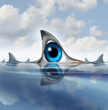 Keep An Eye Out. For risk and insider metaphor as a human eye shaped as a shark dorsal fin in the ocean with sharks swimming around in the ocean as a symbol of Royalty Free Stock Image