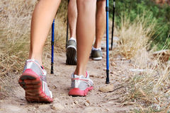 Keep those feet going!. Close up of people walking along a hiking trail Stock Images