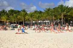 Keep fit class on caribbean beach Royalty Free Stock Image