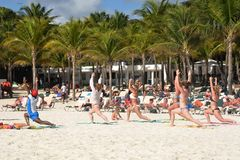 Keep fit exercise class on caribbean  beach Stock Photos