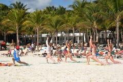 Keep fit exercise class on caribbean  beach Stock Photos