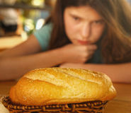 Keep fit girl with bread loaf seduction. Teen girl with bread loaf seduction dieting loosing weight Royalty Free Stock Photos