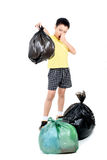 Keep garbage in bag for eliminate. Young Asian boy carry garbage in plastic bag that bad smell for eliminate on the white background Royalty Free Stock Images