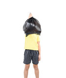 Keep garbage in bag for eliminate. Young asian boy carry garbage in plastic bag for eliminate on the white background Stock Images