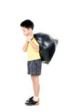 Keep garbage in bag for eliminate. Young asian boy carry garbage in plastic bag for eliminate on the white background Royalty Free Stock Photo
