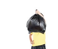 Keep garbage in bag for eliminate. Young asian boy carry garbage in plastic bag for eliminate on the white background Royalty Free Stock Photography