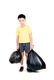 Keep garbage in bag for eliminate. Young asian boy carry garbage in plastic bag for eliminate on the white background Royalty Free Stock Image