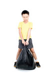 Keep garbage in bag for eliminate. Young asian boy carry garbage in plastic bag for eliminate on the white background Stock Image