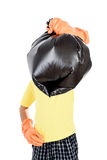 Keep garbage in bag for eliminate. Young Asian boy in orange gloves carry garbage in plastic bag for eliminate on the white background Royalty Free Stock Photo