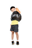 Keep garbage in bag for eliminate. Young Asian boy in orange gloves carry garbage in plastic bag for eliminate on the white background Royalty Free Stock Images