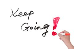 Keep going. Hand writing Keep going words on white board Stock Photos
