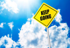 Keep going message on road sign Royalty Free Stock Photography