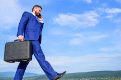 Keep going towards your goal. Businessman formal suit carries briefcase sky background. Businessman solving business royalty free stock photography
