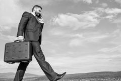 Keep going towards your goal. Businessman formal suit carries briefcase sky background. Businessman solving business stock photos