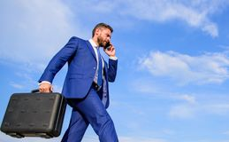 Keep going towards your goal. Businessman formal suit carries briefcase sky background. Entrepreneur in motion royalty free stock image