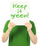 Keep It Green. A young man holding a sign with an environmental message Stock Photos