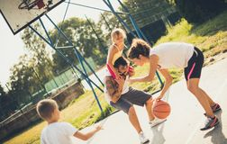 Keep a healthy life. Family playing basketball royalty free stock image