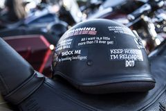 Keep honking I`m reloading sticker on black motorcycle helmet royalty free stock photography