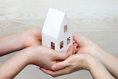 Keep the image of the house in hands. People carefully keep the image of the house in hands Royalty Free Stock Photo