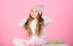 Keep knitwear soft after washing. Soft knitted accessory. Tips for caring for knitted garments. Child long hair warm. Soft woolen hat enjoy softness. Kid girl royalty free stock photo