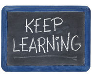 Keep learning on blackboard Royalty Free Stock Photos
