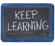 Keep learning on blackboard Royalty Free Stock Photos