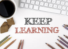 Keep Learning concept. White office desk Stock Photography